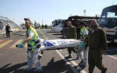 Israeli emergency workers carry a body bag away from the site of the Burgas attack. (Dano Monkotovic/FLASH90/JTA)