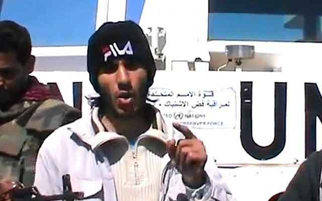 A Syrian rebel spokesman announces the capture of 21 Filipino peacekeepers on the Golan Heights, Wednesday, March 7, 2013 (photo credit: YouTube)