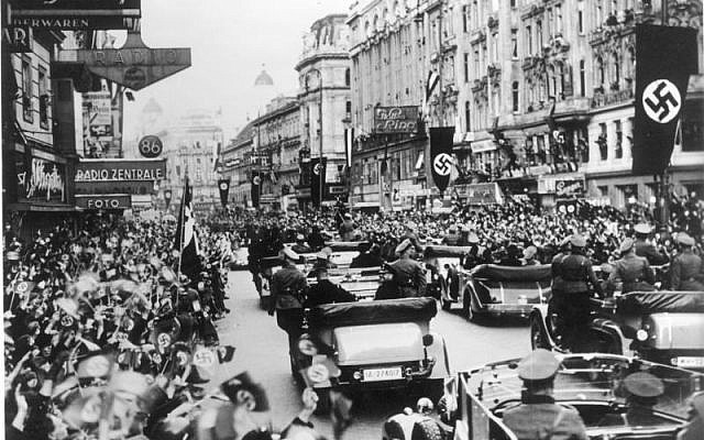 Cheering crowds in Austria welcoming Hitler in 1938. (photo credit: CC BY-SA German Federal Archives. Wikimedia commons)