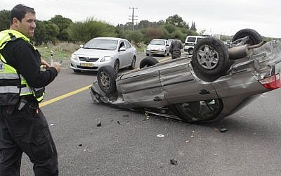 Illustrative photo of an overturned vehicle (photo credit: Edi Israel/Flash90)