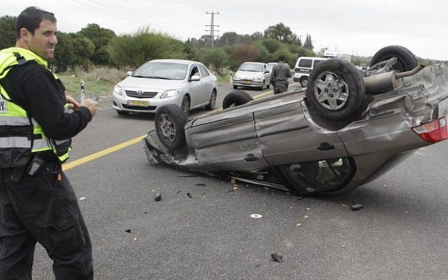 Illustrative photo of an overturned vehicle (photo credit: Edi Israel/Flash90)