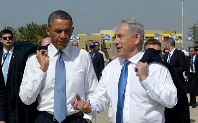 US President Barack Obama and Prime Minister Benjamin Netanyahu go informal at Ben Gurion Airport, March 22, 2013 (photo credit: Avi Ohayon/GPO/Flash90)