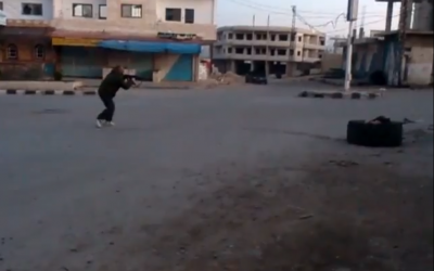 A rebel fighter engaged in battle Thursday in Khan Arnabeh (photo credit: screenshot/YouTube)