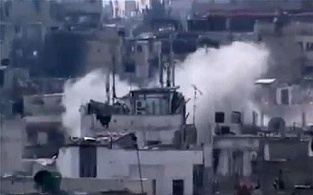 Smoke rises from buildings due to heavy shelling in Homs, Syria, Monday, March 11, 2013. (AP Photo/Shaam News Network via AP video)