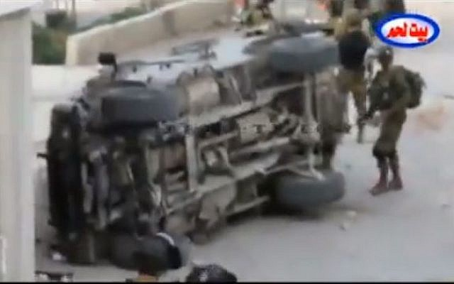 IDF soldiers inspect a jeep that was overturned in Bethlehem, on March 30, 2013. (image capture: YouTube)