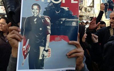 Protester at anti-Obama demonstration in Ramallah on Tuesday, one day ahead of the US president's visit to the region. (Photo credit: Huwaida Arraf/Twitter https://twitter.com/huwaidaarraf/status/314053383860412417/photo/1)