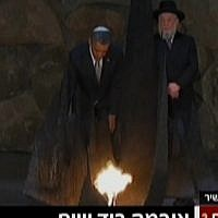 President Obama rekindles the 'eternal flame' at the Yad Vashem Holocaust Memorial Museum on Friday (photo credit: Channel 2 screenshot)