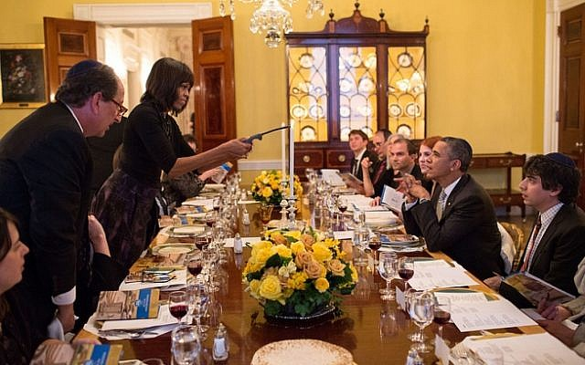 US President Barack Obama and First Lady Michelle Obama seen hosting a previous Passover Seder for family, staff and friends in the Old Family Dining Room of the White House. (Official White House Photo/Pete Souza)