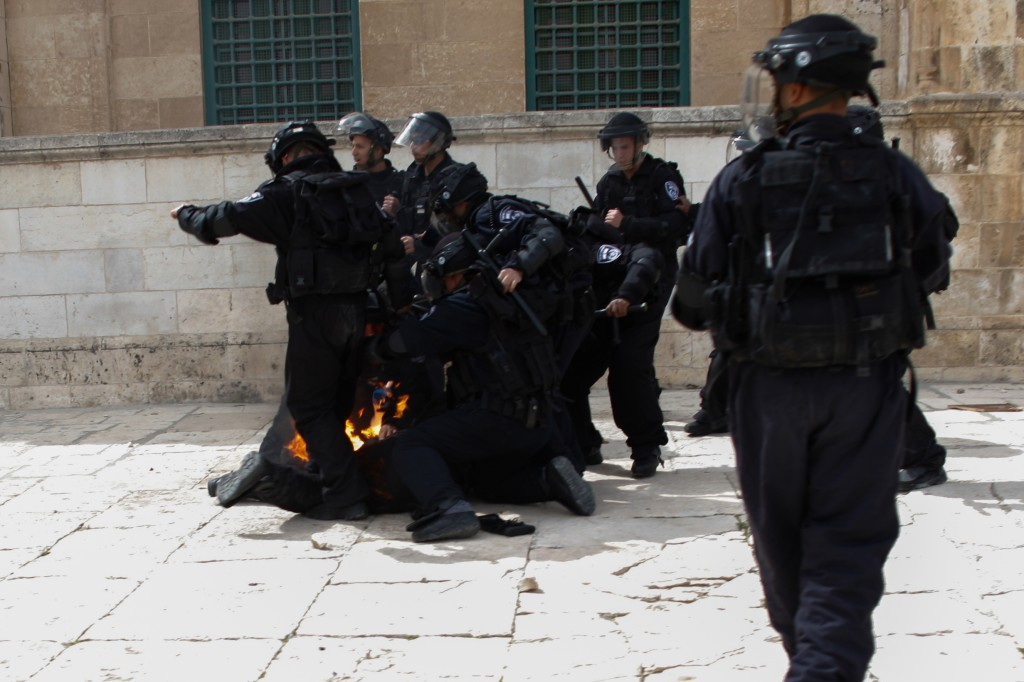 An Israeli policeman was hit by a Molotov cocktail in a March 8 riot at the shrine, suffering light wounds (Photo credit: Sliman Khader/Flash 90)