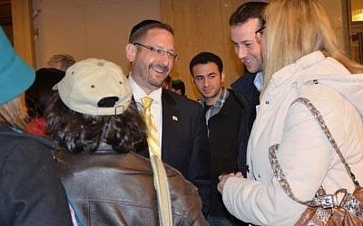 Yesh Atid MK Dov Lipman meets with members of the audience after being publicly interviewed at the Jerusalem Great Synagogue on March 9 at an event marking The Times of Israel's first anniversary (photo credit: Sharon Marks Altshul / the Real Jerusalem Streets)