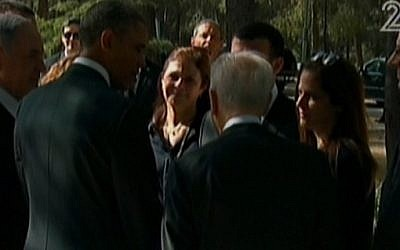 President Obama meets with members of the family of the assassinated prime minister Yitzhak Rabin, as Prime Minister Netanyahu and President Peres look on, at Rabin's grave on Friday, March 22 (photo credit: Channel 2 screenshot)