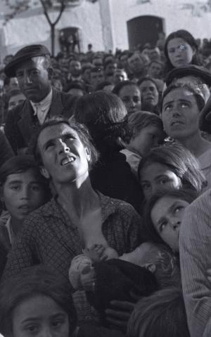 Seymour captured Spaniards at a political rally in Badajoz in 1936. (Estate of David Seymour/Magnum Photos)