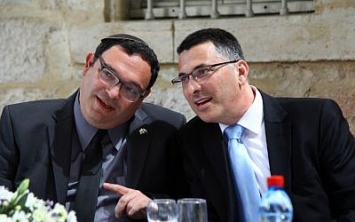 Incoming Education Minister Shai Piron with new Interior Minister Gideon Sa'ar at the Education Ministry ceremony marking the handover. (Photo credit: Sasson Tiram)