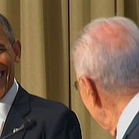 US President Barack Obama smiles at his Israeli counterpart, Shimon Peres, during a joint presentation at the President's Residence in Jerusalem, Wednesday (photo credit: Channel 2)