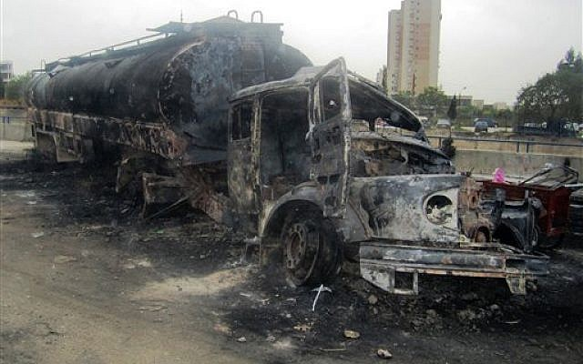 A Syrian fuel tanker which was set on fire late Thursday by anti-Syrian regime protesters, Friday March 15, 2013 (photo credit: AP Photo)