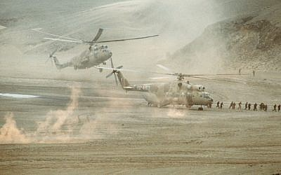 Helicopters land in the desert (illustrative photo credit: Kirby Harrison/Wikimedia commons)