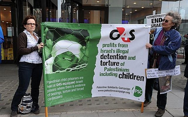 Palestine Solidarity Campaign protesters demonstrating against G4S in front of their offices in England. (photo credit: CC BY Stephen Sizer/Palestine Solidarity Campaign, Flickr)
