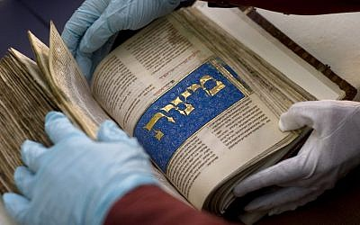 An ancient Hebrew manuscript with illuminations made by master Italian artists from the late 1400s is presented to the media after its restoration at a paper laboratory at the Israel Museum in Jerusalem, Thursday, April 22, 2010 (photo credit: AP/Sebastian Scheiner)