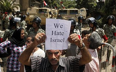 An Egyptian protester holds an anti-Israel slogan near the Israeli embassy in Cairo, Egypt, Sunday, Aug. 21, 2011. (AP Photo/Amr Nabil)