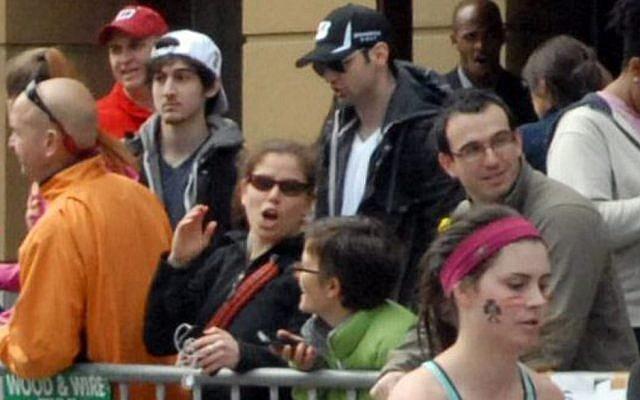 This Monday, April 15, 2013 photo shows Tamerlan Tsarnaev, in blue baseball cap, and Dzhokhar A. Tsarnaev, in white baseball cap. This image was taken approximately 10-20 minutes before the Boston Marathon blast. (Photo credit: AP/Bob Leonard)