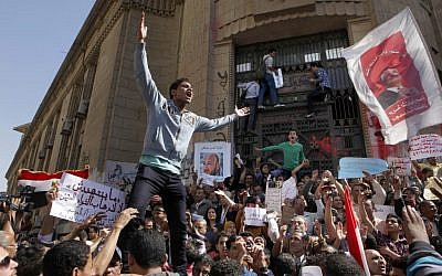 Egyptian protesters chant slogans against Islamist President Mohammed Morsi, during a protest in front of the prosecutor general's office in Cairo, Egypt, Friday, March 29, 2013. (photo credit: AP/Amr Nabil)