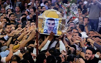 Egyptian Christians carry the coffin of Morqos Kamal, at the Saint Mark Coptic cathedral in Cairo, Egypt, Sunday, April 7, 2013. (photo credit: AP/Amr Nabil)