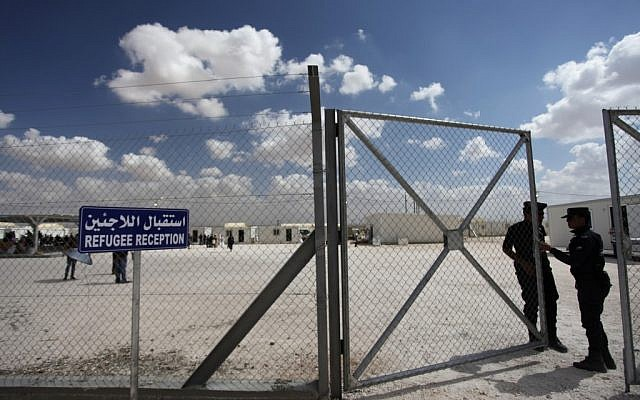 Illustrative photo of guards at the entrance to the Mrajeeb al-Fhood refugee camp in Zarqa, Jordan, April 10, 2013. (AP/Mohammad Hannon)