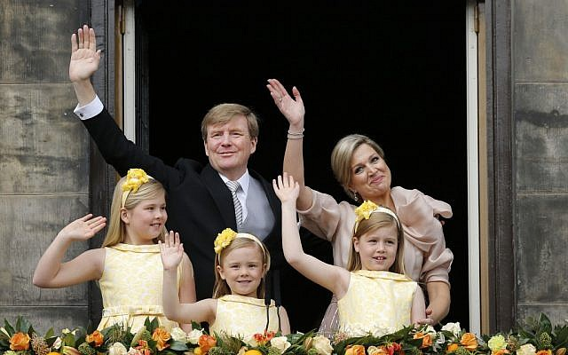 Dutch King Willem-Alexander and Queen Maxima appear on the balcony of the Royal Palace with their children, from left: Catharina-Amalia, Ariane, and Alexia in Amsterdam, The Netherlands, on Tuesday April 30, 2013. (photo credit: AP Photo/Daniel Ochoa de Olza)