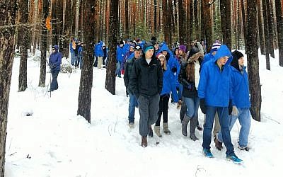 March of the Living participants in the Lupachowo Forest, site of a mass execution of Jews from the town of Tykocin, in 2013 (Courtesy)