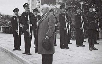 Israel's first prime minister David Ben-Gurion stands at attention as the national anthem, Hatikva, is played at the Knesset opening ceremony in 1949. (photo credit: GPO/Hugo Mendelson)