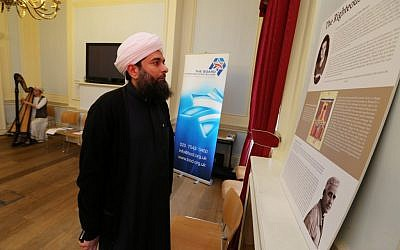 Sheikh Ibrahim Mogra views a new Board of Deputies display on righteous Muslims during the Holocaust. (photo credit: Marc Morris/courtesy)