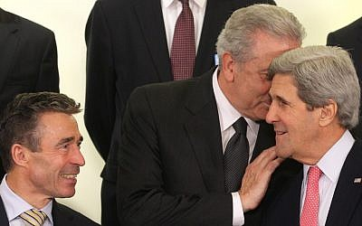 Greek Foreign Minister Dimitrios Avramopoulos (center) talks to US Secretary of State John Kerry (right) and NATO Secretary General Anders Fogh Rasmussen, April 23 (photo credit: Yves Logghe/AP)