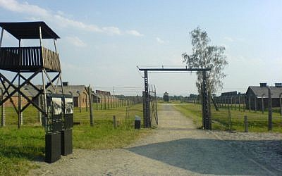 A guard tower at the Auschwitz-Birkenau concentration camp in Poland (photo credit: CC BY Fish and karate, Wikimedia Commons)