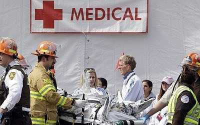 Medical personnel work outside the medical tent in the aftermath of two blasts that exploded near the finish line of the Boston Marathon, Monday, April 15, 2013 (photo credit: AP/Elise Amendola)