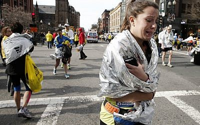 A runner leaving Copley Square after the bombing on Monday. (photo credit: AP/Winslow Townson)