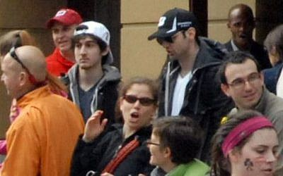 Brothers Dzhokhar (left) and Tamerlan Tsarnaev in an image taken approximately 10-20 minutes before the blast near the finish line of the Boston Marathon. (photo credit: AP/Bob Leonard/File)