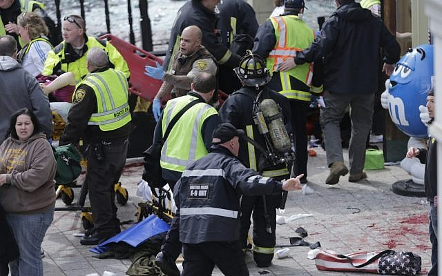 Medical workers aid injured people at the finish line of the 2013 Boston Marathon following an explosion in Boston on April 15, 2013 (AP/Charles Krupa)