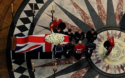 The coffin containing the body of former British prime minister Margaret Thatcher leaves the ceremonial funeral at St Paul's Cathedral in London, Wednesday April 17 (photo credit: AP Photo/Gareth Fuller, Pool)