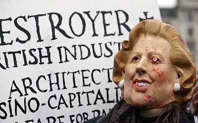 A protester wears a mask depicting former British Prime Minister Margaret Thatcher during a party to mark her death in central London's Trafalgar square, Saturday, April 13, 2013 (photo credit: AP/Lefteris Pitarakis)