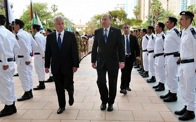 US Defense Secretary Chuck Hagel, center left, walks with Defense Minister Moshe Ya'alon in Tel Aviv, April 2013 (photo credit: Ariel Hermoni/Israeli Ministry of Defense)