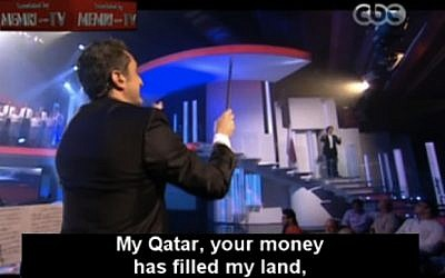 "Egyptian satirist Basem Youssef conducts a choir on his television show ""El-Bernameg"" April 5 (photo credit: Image capture MEMRI TV)"