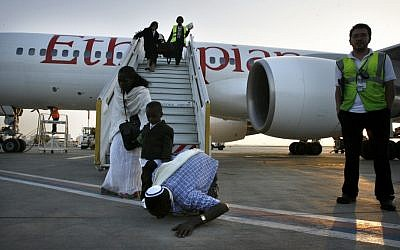 A Falash Mura man kisses the ground as the flight from Ethiopia lands at the airport in Israel in May 2008 (photo credit: Michal Fattal/Flash90)