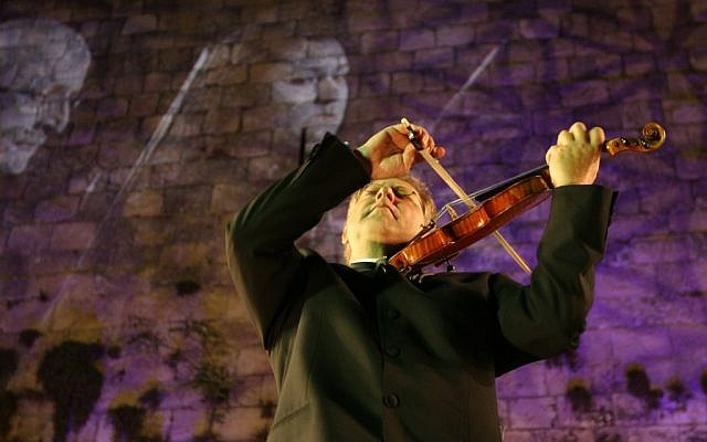Maestro Shlomo Mintz perform at the 2008 Violins of Hope concert in front of the walls of the Old City of Jerusalem. (photo credit: Anna Kaplan/ Flash90)