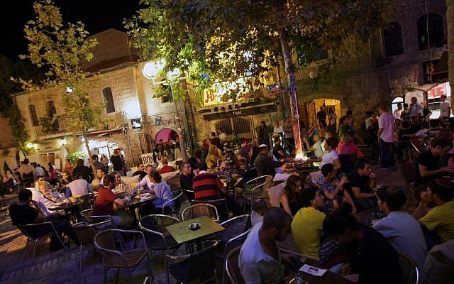 Taking it easy at a cafe in downtown Jerusalem (photo credit Kobi Gideon/Flash90)