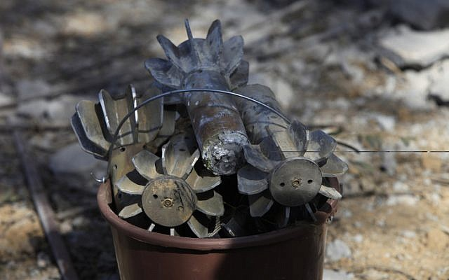 A bucket of mortar shell pieces from bombs fired by Palestinians in the Gaza Strip into Israel, March 19, 2011. (Tsafrir Abayov/Flash90)