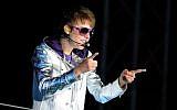 Canadian pop star Justin Bieber performs during a concert in Tel Aviv, April 14, 2011. (photo credit Gili Yaari/Flash 90)