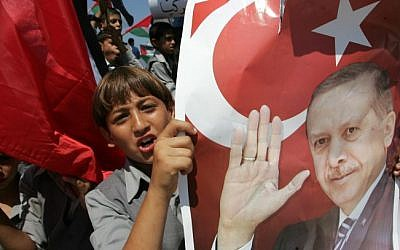 Palestinian students in Gaza hold up pictures of Recep Tayyip Erdoğan. (photo credit: Abed Rahim Khatib/Flash 90)
