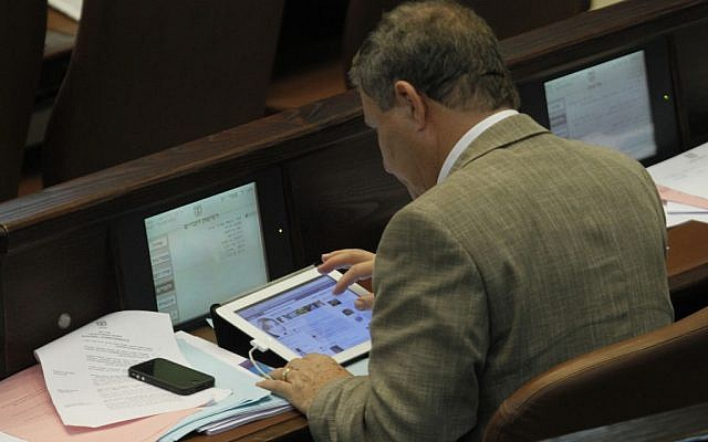 MK Meir Sheetrit surfing Facebook in the Knesset in 2011. (photo credit: Miriam Alster/Flash90)