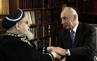 President Shimon Peres shakes hands with Shas spiritual leader Rabbi Ovadia Yosef in Jerusalem last year (photo credit: Kobi Gideon/Flash90)