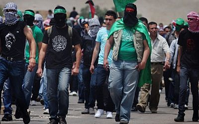 Palestinian protesters during a demonstration outside Ofer Prison near Ramallah, on May 2, 2012, in solidarity with prisoners held in Israeli jails. (photo credit: Issam Rimawi/Flash90)